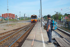 The man expects arrival of the passenger train on the platform of the station Ayutthaya Stock Photos