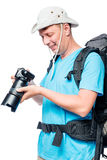 Man in an expedition with a camera on a white. Background Stock Photos