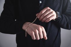 Man with a expensive bracelet. Fashion accessories and jewelry stock image
