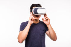 Man experiencing virtual reality isolated on white background. Portrait of young excited man experiencing virtual reality isolated on white background Royalty Free Stock Image