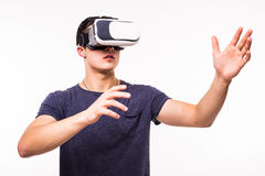 Man experiencing virtual reality isolated on white background. Man wearing virtual reality using a VR headset on white background Stock Image