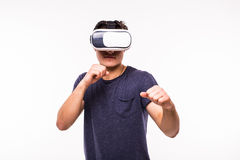 Man experiencing virtual reality. Portrait of young excited man experiencing virtual reality isolated on white background Royalty Free Stock Photos