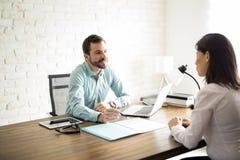 Man explaining agreement to client Stock Photos