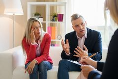 Man explaining himself during couple`s therapy session stock photography