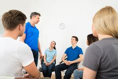 Man Explaining To His Friends Royalty Free Stock Image