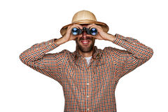 Man explorer in hiker shirt looking through binoculars with traveler hat. Man explorer in hiker shirt looking through binoculars with traveler hat, isolated Stock Images