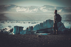 Man explorer lookig at Jokulsarlon lagoon, Iceland. Man explorer lookig at Jokulsarlon lagoon, Iceland Royalty Free Stock Image