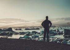Man explorer lookig at Jokulsarlon lagoon, Iceland. Stock Photo