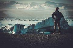 Man explorer lookig at Jokulsarlon lagoon, Iceland. Stock Photos