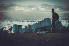 Man explorer lookig at Jokulsarlon lagoon, Iceland. Stock Photography