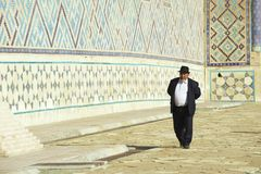 Man explores mausoleum of Khoja Ahmed Yasavi in Turkistan, Kazakhstan. Stock Image