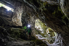 Man exploring cave Royalty Free Stock Photography