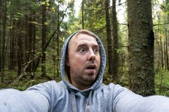 A young man in a thick forest was frightened of something royalty free stock photos