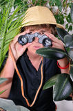 Man exploring jungle Stock Images
