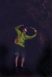 Man exploring underground dark cave. Man walking and exploring dark cave tunnel with light headlamp underground. Mysterious deep dark, explorer discovering Royalty Free Stock Image