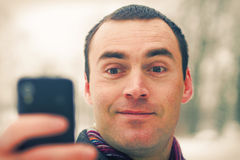 Man expresses emotion with mobile phone Stock Photo