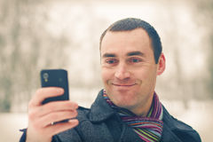 Man expresses emotion with mobile phone Stock Photography