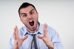 Man expressing frustration. Angry business man expressing frustration, portrait of young handsome businessman, concept of executive yelling, conversation problem Stock Photos