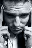Man expressing headache or stress concept. Closeup portrait of stressed businessman with headache stock image