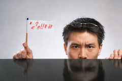 Man expressing her angry with flag Royalty Free Stock Photos