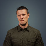 Man with an expression of disgust. Portrait of young man with an expression of disgust Royalty Free Stock Photography
