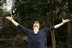 Man Extending Arms in Salutation Yoga Pose Royalty Free Stock Photography