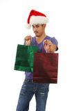 Man extending a Christmas gift Royalty Free Stock Photo