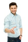 Man extending his hand for a handshake Royalty Free Stock Photos