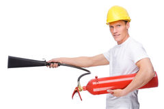 Man with extinguisher Stock Images
