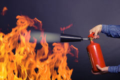 Man with extinguisher. Fighting a fire stock photos