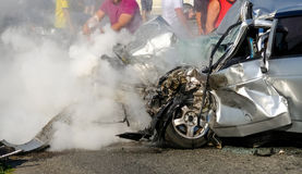 Man extinguishes the car with a fire extinguisher. Royalty Free Stock Photography
