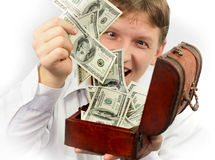 Man extracting money from trunk Stock Photography