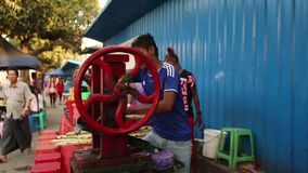 A man extracting sugar cane juice in Phnom Penh stock video footage