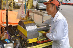 Man extracting sugar cane juice Royalty Free Stock Photo