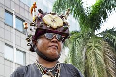 A man with extraordinary headdress.
