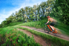Man extreme biking blurred Royalty Free Stock Photo