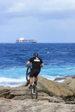 Man extreme biking on rocky shore Royalty Free Stock Photography