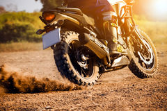 Man extreme riding touring enduro motorcycle on dirt field Royalty Free Stock Photography
