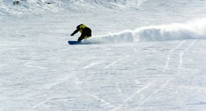 A man extreme snowboard riding. With snow cloud Royalty Free Stock Photography