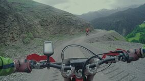 Enduro journey with dirt bike high in the Caucasian mountains with Buggy. Man extreme sport trip with dirtbike and buggy in the mountains and fields stock footage