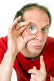 Man with eye magnified Royalty Free Stock Images