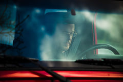 Man with eyeglasses  in car read text message Royalty Free Stock Images