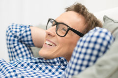 Man With Eyeglasses Contemplating. Portrait Of Happy Man Contemplating With Eyeglasses Royalty Free Stock Image