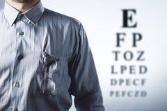 Man with eyeglasses. Eye chart Royalty Free Stock Photo