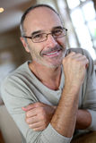 Man with eyeglasses sitting at home Royalty Free Stock Photo