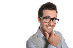 Man with eyeglasses standing on white wall Royalty Free Stock Photos