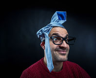 Man in eyeglasses with tie on his head. Stock Image
