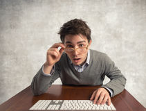 Man with eyeglasses. Young man in front of the PC monitor Stock Images