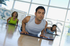 Man With Eyes Closed Exercising On Mat Royalty Free Stock Photography