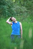 Man with eyes closed exercising on meadow royalty free stock photos
